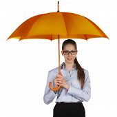 image of debonair  - Happy young woman standing under a large umbrella - JPG