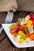 image of jelly babies sugar  - Gummi Bears on a plate as meal with fork  - JPG