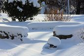 stock photo of blanket snow  - Small backyard patio surrounded by low stone wall under a heavy blanket of snow - JPG
