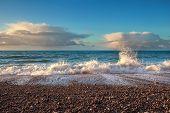 Sunset Light Over Ocean Waves