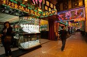 MACAU, CHINA - NOVENBER 1, 2012: Many shops and stores are working in the evening, popular for selling gold jewelry, diamonds and watches.