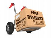 stock photo of free-trade  - Cardboard Box with Free Delivery Slogan on Hand Truck White Background - JPG