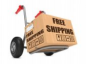 stock photo of free-trade  - Cardboard Box with Free Shipping Slogan on Hand Truck White Background - JPG