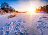 Sunrise Over The Frozen River - Winter Landscape