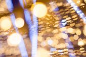Christmas Defocused gold and blue Bokeh lights. Real photograph.