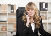 Pretty Businesswoman Listening To A Phone Call
