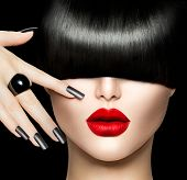 High Fashion Model Girl Portrait with Trendy Hair style, Make up and Manicure. Long Black Fringe Hai