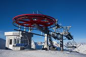 ropeway in snow mountain under blue sky