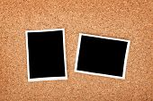 Polaroid photo frames on cork texture background