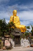 Golden Buddha holding the golden lotus