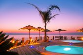 stock photo of piccolo  - Amazing sunset as seen from the pool - JPG