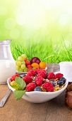 Fresh healthy food on wooden table, with green background