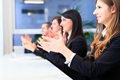Business people applauding during a meeting