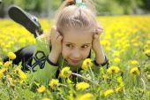 Girl in dandelions
