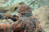 KIEV, UKRAINE -NOV 3: An unidentified member of Red Star history club wears historical German uniform during historical reenactment of WWII, Dnepr river crossing 1943, November 3, 2013. Kiev, Ukraine