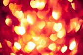 abstract red background with glowing hearts