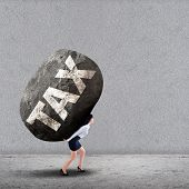 Businesswoman Carrying A Big Rock Of Tax