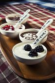 Closeup Cream Dessert With Chocolate And Berries In White Porcelain Bowls On Wooden Plate