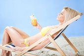 Beautiful Young Woman In Bikini  Driking Cocktail
