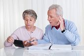 Stressed Senior Couple Calculating Budget
