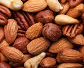 Background texture of assorted mixed nuts including cashew, peca