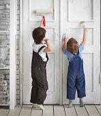 two children paint indoors