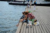 Children Fish On Grafskaya Pier In Sevastopol