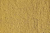Yellow Rough Plaster On Wall Closeup