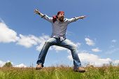 Man With Bandana Is Jumping In The Nature