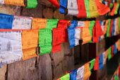 Colorful Prayer Flags With Wooden Wall In Background, Shangri-la, China