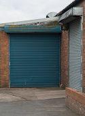 pic of roller door  - Two industrial roller doors one blue one gray - JPG