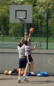 Two men playing outdoor basketball