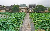 Famous Stone Bridge Leading To Ancient Hongcun Village In Anhui Province, China
