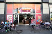 BERLIN, GERMANY - JUNE 11, 2014: A general view of a Dunkin' Donuts coffee shop in  Berlin, Germany,