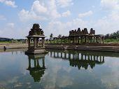 ruins in hampi in a pond