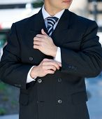 Businessman Adjusting Cuff