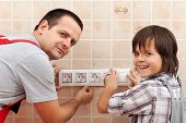 Father And Son Installing Electrical Wall Fixtures