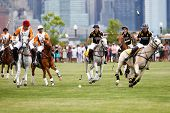 JERSEY CITY, NJ-MAY 31: Nacho Figueras (R) chases the ball during the polo match at the 7th Annual Veuve Cliquot Polo Classic at Liberty State Park on May 31, 2014 in Jersey City, NJ.