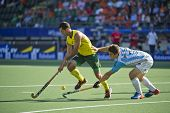 THE HAGUE, NETHERLANDS - JUNE 13: Argeninian Gonzalo Peillat falls short in recovering the ball from Australian star player Jamie Dwyer during the semi finals of the world championships hockey in 2014