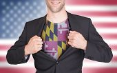 image of maryland  - Businessman opening suit to reveal shirt with state flag  - JPG