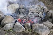 picture of ember  - Closeup of a Fire Pit with Glowing Embers - JPG