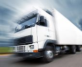 stock photo of semi trailer  - Truck speed. Trucks delivering merchandise. Motion blur