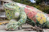 Giant Sculpture Of A Lizard. Providencia Tropical Island, Caribbean Culture. Colombia.