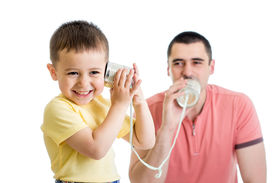 stock photo of tin man  - Kid and dad having a phone call with tin cans - JPG