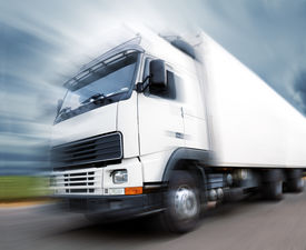 picture of trucks  - Truck speed. Trucks delivering merchandise. Motion blur ** Note: Shallow depth of field - JPG