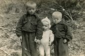 PLOTY SZCZECINSKIE, POLAND, CIRCA 1930:  Vintage photo of three little boys outdoors