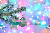 Beautiful Christmas tree with toys on shiny background