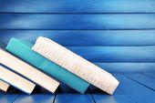 Books on dark blue wooden background
