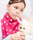 Girl With Thermometer In Her Mouth