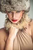 glamour beauty woman wearing fur har and collar looking at the camera